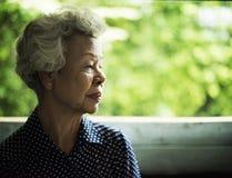 Senior woman staring on somrthing Stock Photography