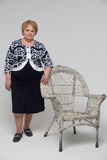 Senior Woman staying near Chair Royalty Free Stock Photo