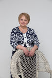 Senior Woman staying and smiling near Chair Royalty Free Stock Images