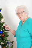 Senior woman stealing candy cane Royalty Free Stock Photo