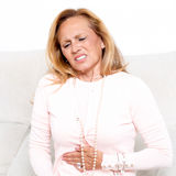 Senior woman with stomachache Royalty Free Stock Images