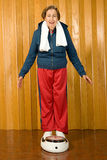 Senior woman stood on scales. Senior women stood on scales Stock Photos