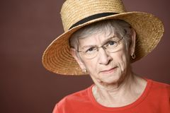Senior woman in a straw hat Stock Photos