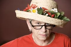 Senior woman in a straw hat Stock Photography