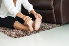 Senior woman stress free on sofa at home stock photo
