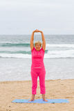 Senior woman stretching Royalty Free Stock Photos