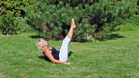 Senior woman is stretching exercising stock video footage