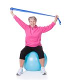 Senior woman stretching exercising equipment. On White Background Royalty Free Stock Photography
