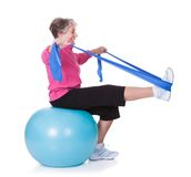Senior woman stretching exercising equipment. On White Background Stock Image