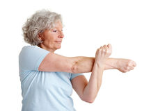 Senior woman stretching her arms Royalty Free Stock Images