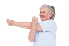 Senior woman stretching her arms Royalty Free Stock Photos