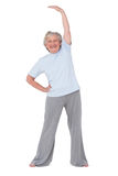Senior woman stretching her arms Stock Images