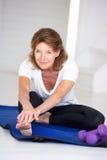 Senior woman stretching at home royalty free stock photos
