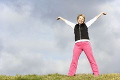 Senior Woman Stretching In Park Stock Image