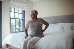 Senior woman suffering from back pain at home Royalty Free Stock Photos