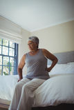 Senior woman suffering from back pain at home Royalty Free Stock Images