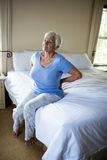 Senior woman suffering from backache in the bedroom Royalty Free Stock Images