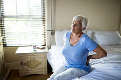Senior woman suffering from backache in the bedroom Royalty Free Stock Photos