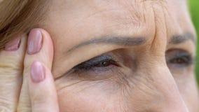 Senior woman suffering eyesight problems, cataract disease, vision correction. Stock photo royalty free stock photography