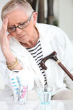Senior Woman Suffering From A Headache Stock Images