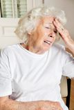 Senior Woman Suffering From Headache Stock Photos