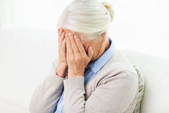 Senior woman suffering from headache or grief Royalty Free Stock Image