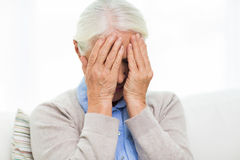 Senior woman suffering from headache or grief stock image