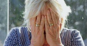 Senior woman suffering from headache 4k. Senior woman suffering from headache at home 4k stock video