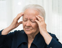 Senior woman suffering from headache Royalty Free Stock Image