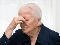 Senior woman suffering from headache Stock Image