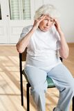 Senior Woman Suffering From Headache Stock Image