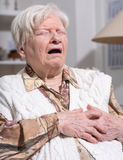 Senior woman suffering from heart attack Royalty Free Stock Photos