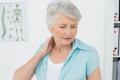Senior woman suffering from neck pain Royalty Free Stock Images