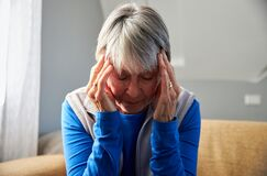 Free Senior Woman Suffering With Stress Or Headache At Home Holding Head In Pain Royalty Free Stock Images - 197394539