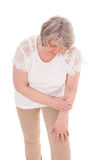 Senior woman suffers from arthrosis. All on white background royalty free stock images