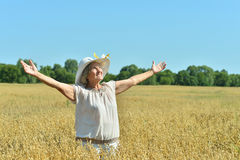 Senior woman in summer field Royalty Free Stock Photos