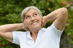Senior woman in summer park Royalty Free Stock Images