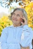 Senior woman in summer park Royalty Free Stock Photo
