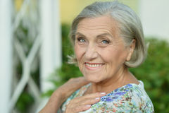 Senior woman in summer park Royalty Free Stock Image