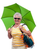 Senior woman with sun umbrella Stock Images