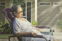 Senior woman sunbathing in the morning royalty free stock image