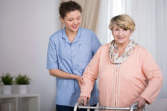 Senior woman and supporting nurse Royalty Free Stock Images