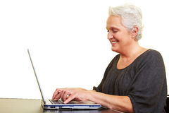 Senior woman surfing Stock Images