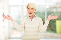 Senior woman surprised. Pretty senior woman looking surprised Royalty Free Stock Photos