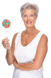 Senior woman with sweets Stock Photography