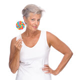 Senior woman with sweets Royalty Free Stock Photo