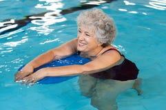 Senior woman swimming Stock Photography