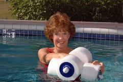Senior woman swimming pool exercises royalty free stock photo