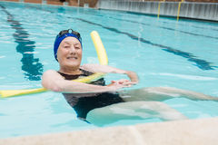 Senior woman swimming in pool Royalty Free Stock Images