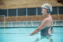 Senior woman swimming in pool Stock Image